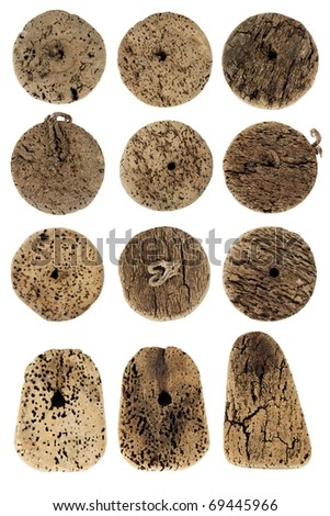 Old fishing net cork on white background - stock photo