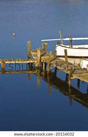 Old fishing ship in a harbor, in Menorca. - stock photo