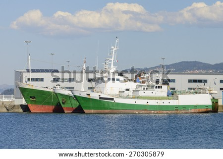 old fishing trawler on the dock - stock photo