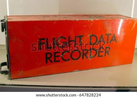 Old Flight Data Recorder on Display Behind Glass, Plane Black Box