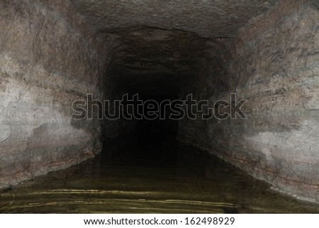 Old flooded military tunnel - stock photo