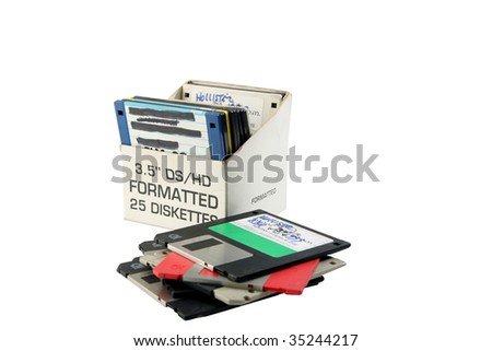 old floppy disc in a box isolated on white room for your text - stock photo