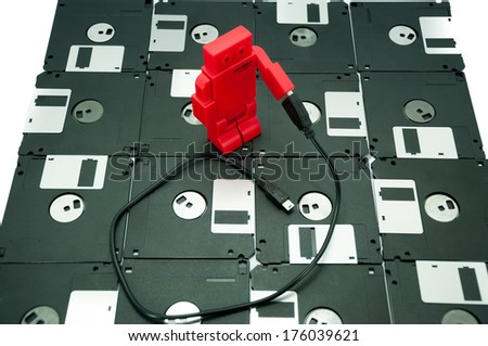 Old floppy disk, and USB port ,memory innovation concept - stock photo