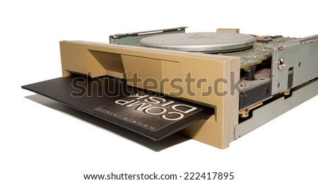 Old floppy disk drive with diskette isolated on white background - stock photo