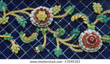 Old floral, ceramic in Wat Pho in Bangkok, Thailand - stock photo