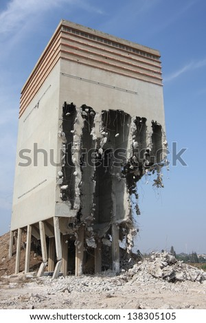 old flour silo building partly demolished - stock photo