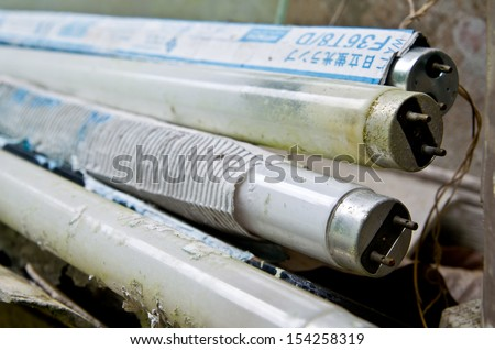old fluorescent bulds that are not used canbe recycled - stock photo