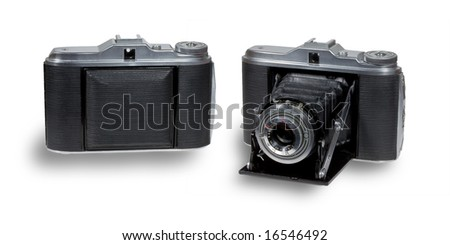 Old folding camera - stock photo