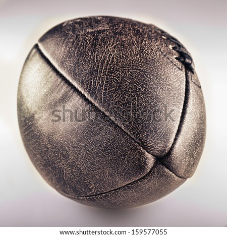 Old football in closeup over a dirty white background - stock photo