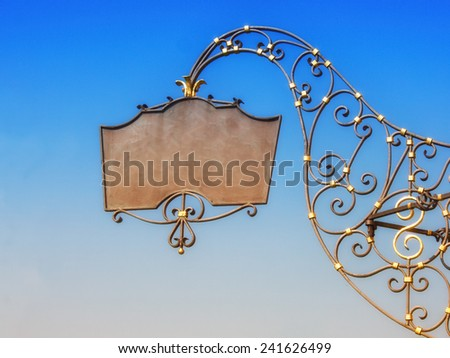 old forge iron sign  with empty space - stock photo