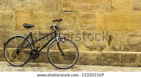 Old forgotten bike  - stock photo