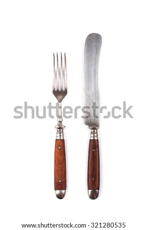 Old fork and knife isolated on white background - stock photo