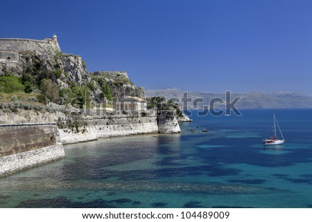 Old Fort, Wall, Temple and Harbor of Corfu, Greece - stock photo