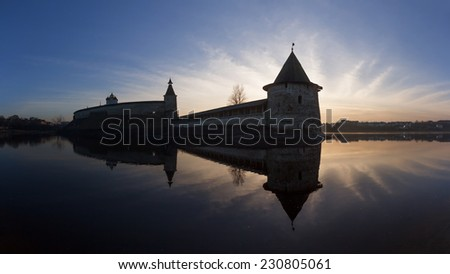 Old fortress on the river in the evening at sunset. Russia, Pskov Kremlin, panorama - stock photo