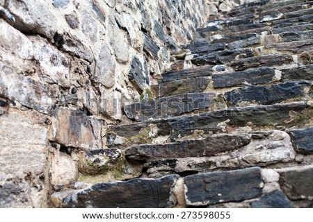 old fortress wall and staircase made from big stones masonry pattern background - stock photo