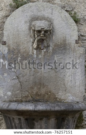 old fountain dating back to Roman times located in Susa Italy - stock photo