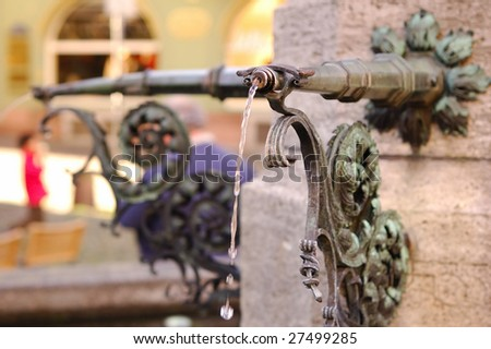 Old fountain in Freiburg, Germany - stock photo