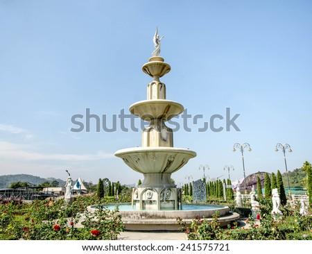 Old fountain in the garden - stock photo
