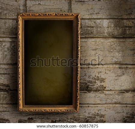Old frame against a grungy, peeling painted wall - stock photo