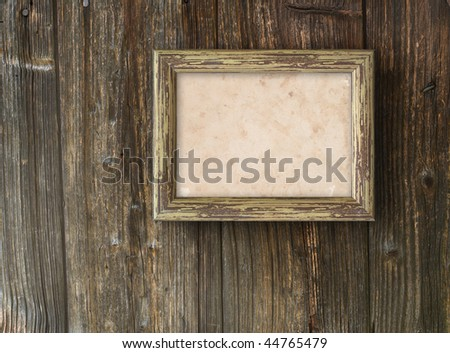Old frame on a wooden background - stock photo