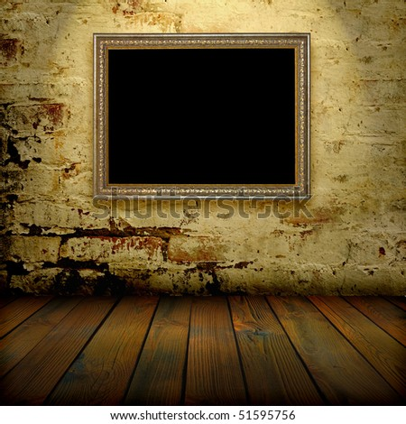 old frame on the wall in the interior grunge - stock photo