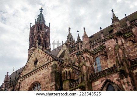 Old Freiburg Munster cathedral in Freiburg, Germany. - stock photo