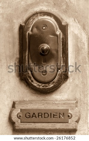 Old French doorbell sepia toned with concierge label