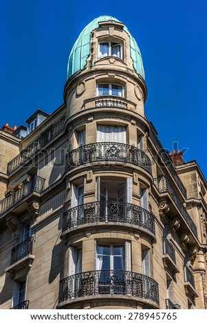 Old French house with traditional balconies and windows. Paris, France.