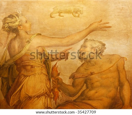 Old fresco with beautiful woman appearing as Moon and Vulcan from Palazzo Vecchio in Florence. - stock photo