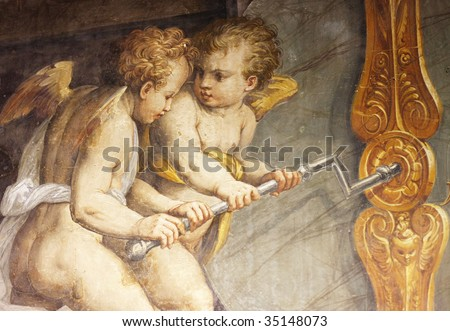 Old fresco with couple of angels from Palazzo Vecchio in Florence - stock photo