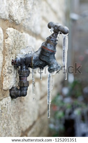 Old frozen water tap - stock photo