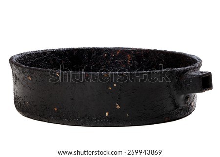 Old frying pan isolated on white background. Selective focus. - stock photo