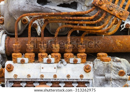 Old fuel injection pump and fuel pipe of 6 cylinder diesel engine - stock photo