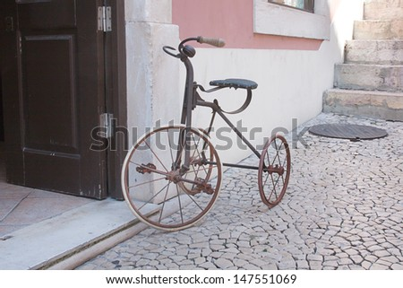 Old, fun tricycle bicycle - stock photo