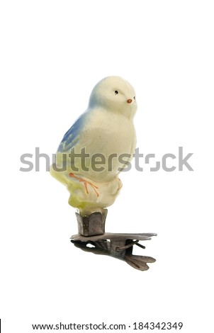 Old fur-tree toy on clips. Birdie - stock photo
