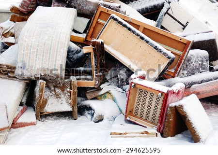 old furniture for disposal under the snow - stock photo