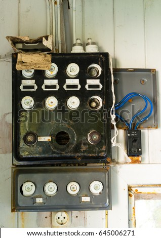stock photo old fuse box in an old abandoned house 645006271 old painted blue grunge vintage wood stock photo 675342088 House Fuse Box Replacement at alyssarenee.co