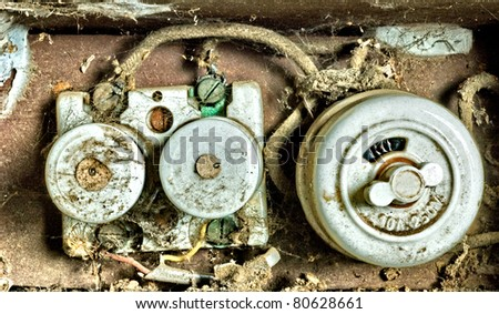old fuse box wit lot of dirt - stock photo