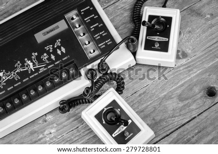 Old game console with very simple wired joysticks - stock photo