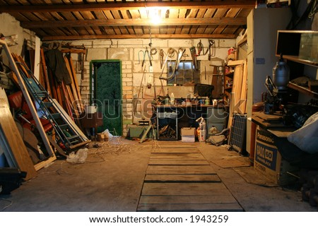 old garage full of tools and stuff - stock photo