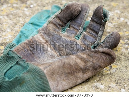 Old Gardening Gloves - stock photo