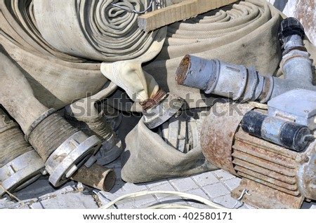 Old gardening tools  and construction lying on a pile in warehouse - stock photo