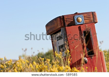 old gas pump in a contrasting environment - stock photo