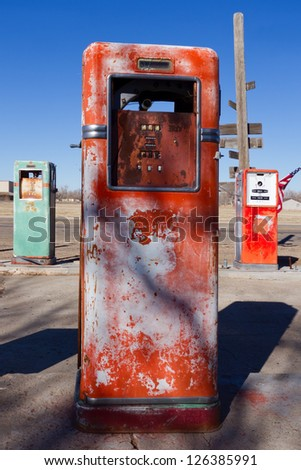 Old gas pumps on historic route 66. - stock photo