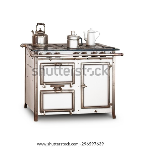 Old gas stove with pot and kettle isolated on white background. Vintage kitchen. Single object with clipping path  - stock photo