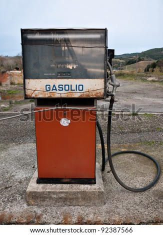 Old gasoline diesel fuel pump with industrial reflection, Italy - stock photo