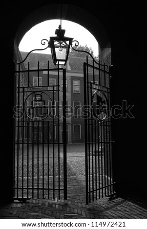 Old gate opening in Leiden - stock photo