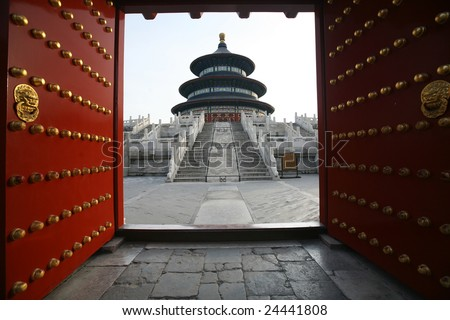 Old gate opening in The Temple of Heaven - stock photo