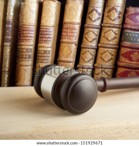 Old  gavel and vintage old book - stock photo