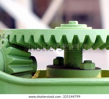 Old gears with cogs for rotational motion - stock photo